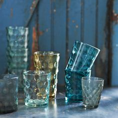 Dimpled glassware. I'm picturing an alfresco late dinner with Indian food and mango lassis filling the glasses.