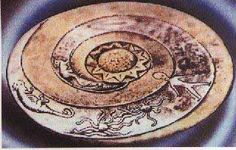 The Lolladoff plate was discovered in Nepal and appears to show a hovering disk shaped object in the center and a small humanoid, resembling an alien that looks remarkably like the classic Grey alien which are reported by nearly all encounters and abductions by aliens.
