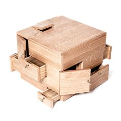 I these kinds of puzzle cubes! :) The Puzzle Cube is a wooden storage system that's perfect for organizing and storing important objects. Wooden Puzzles, Wooden Toys, Wood Projects, Woodworking Projects, Woodworking Box, Secret Box, Cube Puzzle, Cube Storage, Hidden Storage