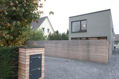 2 Doppelhaushälften R141 Dinslaken Matthias Stickel Architektur Einfahrt