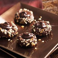 Chocolate Blooms (BHG). Chocolate cookies filled with velvety ganache and rolled in chopped almonds. Nice presentation.