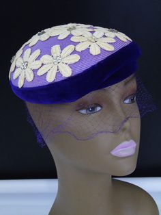 Vintage 50s Evelyn Varon Model Floral Purple Pillbox Hat Vintage pillbox hat with white flowers and silver rhinestone accents Maker / Label: Evelyn Varon Model / Adjustable hero 20 inner circumference Pill box with purple velvet brim Condition : vintage with light signs of foxing Detached net tulle veil needs TLC - has a tear