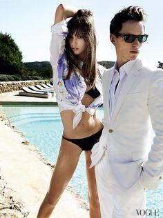 "Take The Plunge - Although today's resort has more import than the old-fashioned ""cruise"" concept, a few sexy bikinis remain key. Etro cotton shirt ($572); select Etro boutiques. Eres bikini top ($135) and bottom ($150); Eres, East Hampton. On Redmayne: Louis Vuitton blazer. Calvin Klein Collection shirt. Prada trousers."
