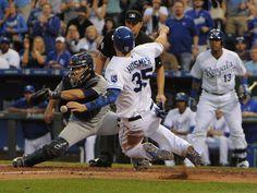 Kansas City Royals first baseman Eric Hosmer (35) scores