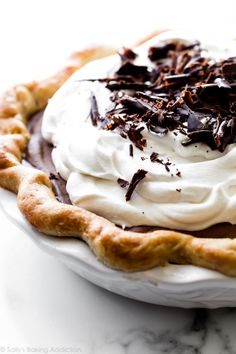 This creamy classic French silk pie combines my best flaky pie crust, smooth and dreamy chocolate filling, and fresh whipped cream on top. This recipe uses cooked eggs, so you don't have to worry about raw. Recipe on sallysbakingaddiction.com