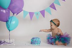 Ft. Worth Cake Smash Photographer | H. Parker Photography | www.HParkerPhotography.com  Cake smash inspiration. Teal and purple girl's cake smash session. First birthday photo ideas.