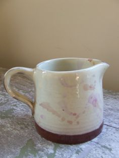 "Pink spatterware jug (3.5"" high)"