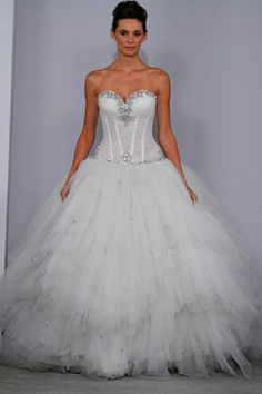 Style 4074 Off white strapless shimmer tulle ball gown with illusion sweetheart bodice and tiered skirt