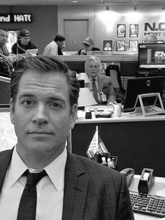 Michael Weatherly on the set of NCIS with Robert Wagner in the background.