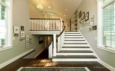 """The """"wow factor"""" starts the moment you walk through the front door into the spacious entryway and behold the sweeping staircase."""