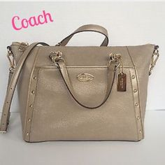 "NWT Coach Leather Colette Satchel Handbag Coach Leather Caviar Grain Colette Satchel Handbag. A Metallic Gold with gold tone hardware. Coach logo plate and metal hang tag. Gold studs down the side for a classy look, front zip pocket, top zip closure. Dual handles w/5"" drop, also adjustable/removable crossbody strap. Interior is a gold color with a zip closure and 2 slip pockets. Measures 12""x10""x5.5"".  This bag is a Beauty that will go with everything and every season!!!  Retails $495 Coach…"