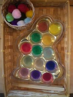 fine motor activity - using tweezers to pick up the pom poms and place them in the appropriate spot.