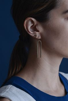 This style is the ultimate minimal & modern every day piece. Sleek and simple, yet full of style. The Jefa shape is a hand carved design that is cast locally in solid brass. The ear wire is made from