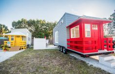 A beautiful red lifeguard stand style tiny house, available for rent at the Go Siesta Resort in Sarasota, Florida.