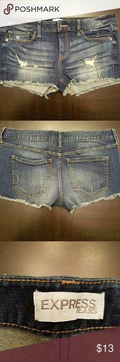 Express-Jean Shorts LIKE NEW!! Medium Wash distressed shorts. Fringe on bottom. Super cute and stretchy so they're very comfortable. No signs of wear at all! Express Shorts Jean Shorts