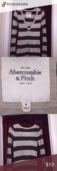 ABERCROMBIE & FITCH long Sleeve Sweater ABERCROMBIE & FITCH long Sleeve Sweater, with long cut V-Neck.  Brown and Gray, Size Medium.  Beautiful sweater to dress u or down. Abercrombie & Fitch Sweaters V-Necks