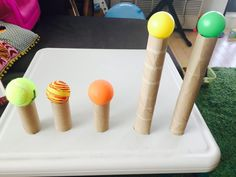 Balancing balls on paper tubes, 25+ activities for toddlers, activities for 18-24 month old, activities for 18 month old, activities for 19 month old, activities for 20 month old, activities for 21 month old, activities for 22 month old, activities for 23 month old, activities for 24 month old, activities for two year old, activities for three year old, learning activities for toddlers