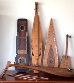 Unusual Stringed Musical Instruments: Ukelin, mountain dulcimer, bowed psaltery, diddley bow and, lying down, biwa