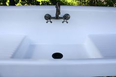 Huge 79 inch Refinished 1922 High Back Double Drainboard Apron Cast Iron Porcelain Farm Sink with New Faucet & Drain. Stamped 1922 by American Standard, this vintage fixture has a 3.5 inch drain, which allows it to be fitted with the modern convenience of a garbage disposal. Comes with adjustable, porcelain legs.