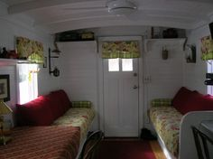 Marcia Weber lives full-time in a Soo Line train caboose that was built in 1909.  One of several photos showing the living area.