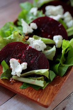 Warm Beet Salad Dressing:  1 head of roasted garlic  ¼ C. orange champagne or white wine vinegar  1 T. orange juice  1 T. honey  1 t. salt  1 t. pepper  ½ C. extra virgin olive oil