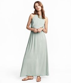 Check this out! Maxi dress in airy woven fabric. Narrow-cut at top with gathers at neckline. Opening at back,  tie at back of neck, elasticized seam at waist, and slit at back. Lined. - Visit hm.com to see more.