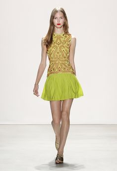 Jenny Packham S/S 16: This is a fun 70s inspired dress! The chartreuse green is lovely with the orange embellishments.