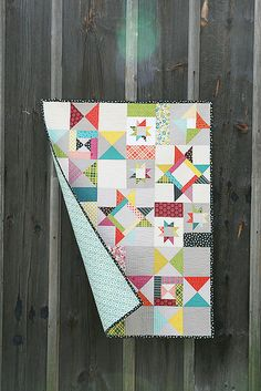 Starfall Quilt by Fresh Lemons - this is amazing! What a beautiful take on the star quilt design. We love the use of gray!