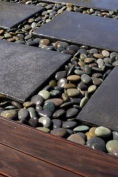 Interesting us of stone pavers and river-wash stone. Can be used as a path or around the perimeter of a house as a splash block.