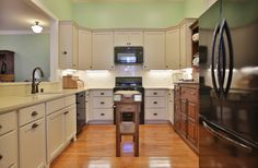 Oval kitchen design with dark and white stained cabinets. Designed and built by Ramage Company.