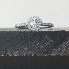 Cushion halo with round diamond engagement ring