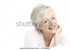 Studio Portrait Of Smiling Senior Woman - stock photo