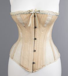 Corset Madame Warren's Date: ca. 1885 Culture: American Medium: cotton, metal, bone, silk Dimensions: Length at CF (a): 16 in. (40.6 cm) Credit Line: Brooklyn Museum Costume Collection at The Metropolitan Museum of Art, Gift of the Brooklyn Museum, 2009; Gift of Mrs. Albert Ogden in memory of Sheldon Stewart, 1964 Accession Number: 2009.300.3262a–c