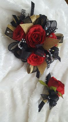 Black gold and red prom corsage from Hen House Designs www.henhousedesigns.net