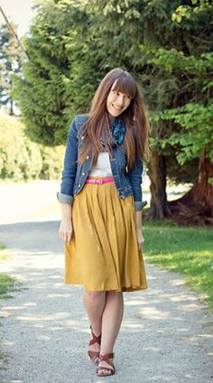 Veronika from Girl and Closet sports a jean jacket and a bright pop of color using a belt or light scarf. Throw in some cute wedges for a springtime look that's perfect for the office.