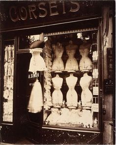 Corsets. Love this vintage pic of corsets in the window.