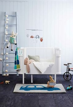 Modern nursery with a touch of vintage - love the ladder idea with stuffed animals