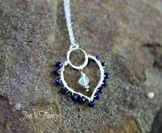 Lapis lazuli sterling wrapped lotus pendant with a rainbow moonstone drop.  Delicate and lovely! You can pick either a size 18 inch or 20 inch sterling silver chain to go with your pendant.   @)--;-----