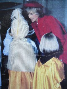 Diana strolled around Guildford Cathedral in a structured red coat and fierce fascinator during a December 1981 visit.