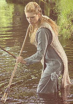 The tabard-style apron dress from The Vikings show. This is episode 1, 1st scene with Lagertha and daughter Gyda fishing.