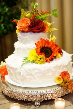 Wedding cake idea...I like the way the frosting looks. I would need different flowers for mine cake.