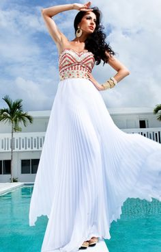 Want to look like a fabulous modern day Greek Goddess?! The Tony Bowls TBE11231 is the right dress for you! The sweetheart neckline is super flattering with red and orange rhinestone beading and embellishments that create a beautiful design completely on the bodice! The waist cinches and supports the pleated white skirt that is super flattering to create a long and lean look! The empire waist dresses look great on everyone - no matter the size or body shape!