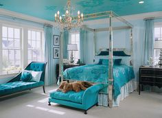 OTT turquoise and light blue bedroom by Margaret Donaldson Interiors. Mirrored canopy bed by Amy Howard.