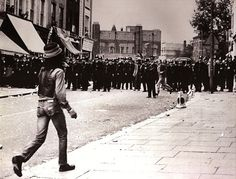 Don Letts facing the police at 1976 Notting Hill Carnival