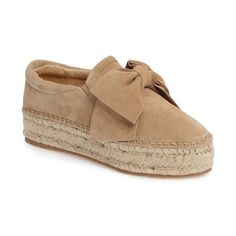 3527913a097 An exaggerated bow and lofty espadrille platform add breezy sophistication  to this lush suede slip-on.
