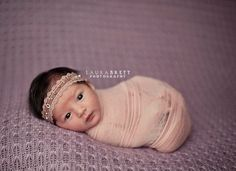 headband. wrap is gorgeous.  and of course the baby is unbelievably gorgeous.