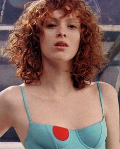 Short curly red hair with bangs                                                                                                                                                                                 More