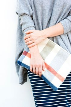 pencil skirt, sweater, plaid clutch