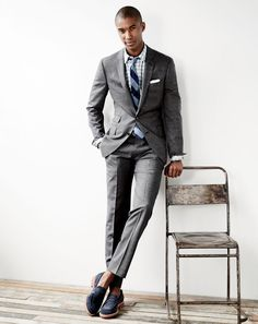 J.Crew men's Ludlow suit jacket and pant in Italian tick-weave, Jaspé cotton shirt in gingham, english linen pocket square and Kenton suede penny loafers.