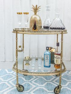 Vintage Brass Drinks Trolley Bar with brilliant gold pineapple - is that a shaker?  I love it.
